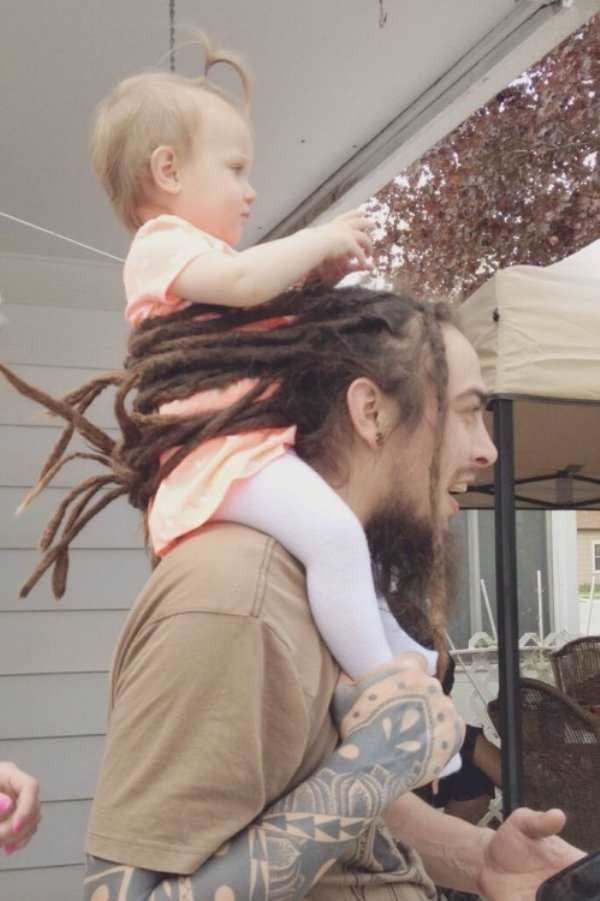 father-secures-kid-with-hair